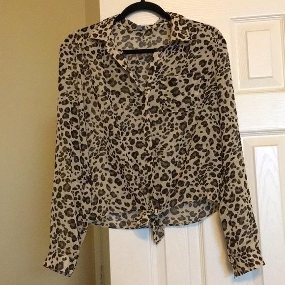 Animal print blouse V-neck ties at the bottom